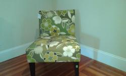 Green floral print with cream and brown acccent chair with brown legs and no arms...