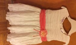 New little girls Easter dresses  Dresses have never been worn. They are size 6 and 12 mos.