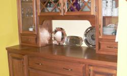 Maple China Cabinet with LOTS of storage. The dimensions of the cabinet are 71 inches wide x 24 inches deep x 84 inches high. In excellent condition.