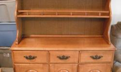 This hutch is in very good condition. It does come apart. The top part just sits on top the cabinets. The only thing that it needs is the last door on the right is missing one of the hinges. It does have the other hinge. Other than that it is in very good