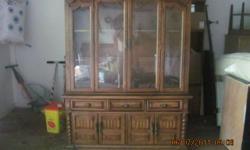 China Hutch, three drawers, three doors.