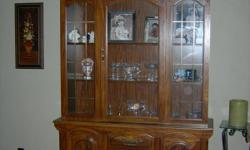 Beautiful oak china hutch with lighted cabinet. Excellent condition. MUST SELL! Moving Sept. 1st and can't take it with. Dimensions: 77H x 54W x 16W Will entertain all offers.