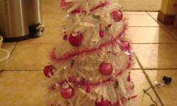 I have made Christmas trees out of clothes hangers and they light up and are decorated BEAUTIFUL. They stand about 1 foot tall. They come in all differt colors.