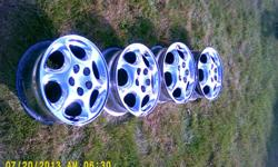 Complete set of 4 original chrome 16 inch rims with inserts. Good appearance. These are about $80 EACH at tire stores. $135 or make offer. Calls only at 810 836 zero six fore zero.