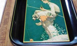 Very nice Coca Cola serving tray from 1985. In great condition. Has a scene with a boy and a fishing pole, and of course a Coca Cola!