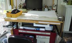 Commercial drafting table. on casters. raises/tilts. excellent condition.