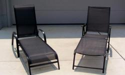 """Outdoor Lounge Chairs, details as follows: Measurements as follows: Approximately 67"""" in Length X 27"""" Wide All black in color Very Sleek and Contemporary in Style Great for Poolside One folds and one does not! Very quality made! Both chairs were purchased"""