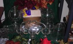 Craft Lot - Pictured front to back- 3 each silver and gold netting poinsettias 12 inch bushes - 1 12 inch bright red poinsettia bush- 2 silver leaf and pomegranate bushes- 2 gold and copper 12 inch fillers- 4 4 ½ inch glass cordial candle cups - 1 4 ½