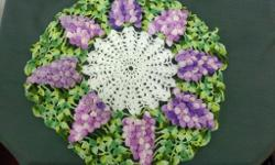 Grape cluster doilies, $15.00 plus $2.50 shipping plus many other crocheted items. Mary A. Sadler POB 464 Jonesnboro, Il. 62952