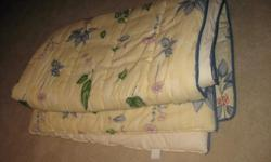 Full size comforter, one pair of lined drapes with tie backs, two valances, two shams and a bed skirt. Gently used. In excellent condition!