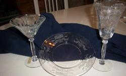 Tiffin Flanders Stemware - clear. 10 of each: plate, water glass, martini glass. Used twice. Selling to make room in my home. I'm selling for a very reduced rate. See pictures for detailed etching. Antique dealers welcome.