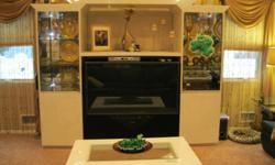 Custom acrylic lighted entertainment center with 52 inch Mitsubishi TV, matching coffee table and side tables, paid $5000 asking $500 moving south. Quality made, fits any decor for elegant look. call 516 804-5797
