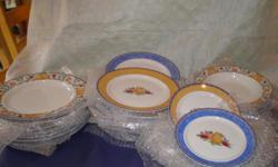 """Discontinued Fiance Fruit blue and orange rimmed dishes. 6- bread and butter plates valued at $49.99 ea. 8-salad plates (1 has chip in rim) valued at $19.99 ea. 7- rim soup bowls valued at $ 14.99 ea. 7-11"""" dinner plates valued at $49.99 ea. Total value $"""