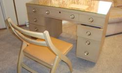 All wood, blonde, 1960s style desk. Call 388-7013 or 323-0477