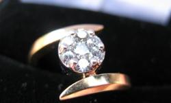 14ct. yellow gold diamond ring, invisibly set with 7 round brilliant cut diamonds, total weight 0.50 ct. Appraised at $971.00, asking $650.00 OBO