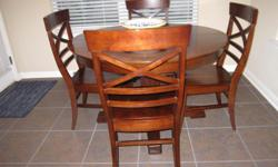 """DINNING/KITCHEN ROUND TABLE 48"""", HAS A HIDDEN PANEL IN THE MIDDLE OF THE TABLE WHICH MAY BE PULLED OUT AND EXTENDS TO AN OVAL SHAPE TABLE 48""""x66"""" LONG. HAS 6 MATCHING CHAIRS, ONLY 4 YEARS OLD. EXCELLENT CONDITION. CALL 210-566-4353."""
