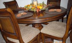 54 inch Round pedistal table, 4 chairs, buffet is 56 in. long, 35 in. tall. Three years old. Call -- before 8pm