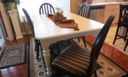 Broyhill - cream dining room table - 68x44 with two leaves.  Will seat 12 people.  Chairs black wood with black striped fabric seats.  Perfect condition.  Also, 2 countertop bar stools, black with red tied on fabric seats.