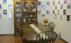 Diningroom Furniture-----very large table with leaves, 4 chairs and 2 arm chairs. All chairs with cussions. Hutch wood and glass with light inside. All pieces solid wood. Valued at Pennys $2543. My price $800 732-222-0317
