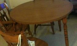 MEDIUM OAK-COMES WITH TWO CAPTAINS CHAIRS AND TWO STRAIGHT BACK CHAIRS-ALSO COMES WITH ONE LEAF-VERY GOOD CONDITION