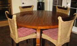 """Beautiful Portuguese Dining Table 5 Woven Banana Leaf Chairs 60"""" Round Slatted Table Teak wood Paid $1300 Excellent condition, family has outgrown! call 702-379-9822"""