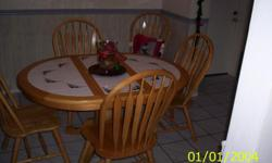DINING ROOM TABLE TILE TOP, GREAT CONDITION $125.00 FIRM MUST SEE PLEASE CALL 727 857-3450