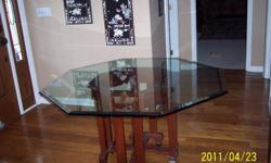"Dinning table with octagon shaped 3/4"" thick beveled glass top on a custom mahogany pedestal. 30"" tall x 54"" wide across top. Very good condition 404-307-3683"
