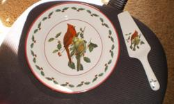 this dish set has 4 cups and a cake servers and has never been used. and this dish set is great for a great gift for the holidays. or christmas or etc.