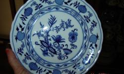 Blue Onion pattern, dinner service for 4, includes dinner plate, dessert plate, soup bowl dessert saucer, cup & saucer. Also includes Dessert set for 6, with teapot. also serving platter, serving bowl, cream & sugar. Total of 10 cups, saucers, dessert