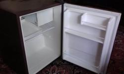 This fridge works great. Used, but clean, lots cheaper than a new one. 19W x 18D x 24H inches outside dimensions. Located in Ames.
