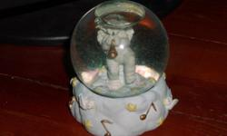 Adorable Dreamsicles cherub with horn in a waterglobe. Has stars, doves and musical notes around base. Has sticker on the bottom that reads Westland, Item No. D6508. Second sticker reads Manufactured under license from Cast Art Industries Inc. In good