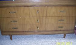Light pecan wood 6 drawer dresser. In pretty good condition. 724-433-7813