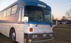 40' eagle conversion to motor home 6 bunks 2 A/C units Refrigerator Micro wave Solid oak cabinets and through out interior On board black and fresh water tanks Toilet room with vanity On board generator 2 couches Dinette booth -