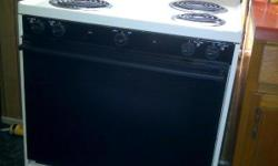 4 burner electric stove, with a drawer in the bottom underneath the oven. Hasn't been used very little.