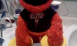 elmo is still in good condition, Elmo sings and dances. It is a fun toy to give for christmas :). Depending on where you live i will be glady to bring it to you.