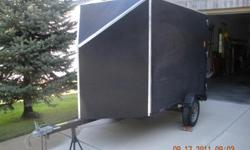 V nosed enclosed motorcycle trailer. Steel bed, plywood enclosure. Complete with spare wheel, chock, tie-down straps, ramp, security door locks, hitch and tow bar locks, and tow bar. Will hold HD Ultra plus lots of luggage. Ready to go.
