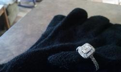 Beauitful shiny, almost new ring. 1/2 carat center, 1 3/8 carat total. 14WG Size 7 CASH ONLY call --