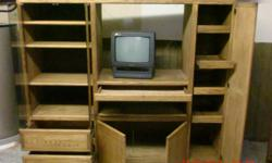 """Great entertainment center to be used for whatever....books? decoration?? or what it is intended for..TV and stereo cabinet. Furniture piece is on wheel and measures 59"""" tall x 67.5 wide. TV works great. You need to pick up."""