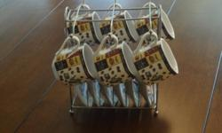 Im selling a very nice, never used espresso set. It comes with six cups, matching saucers and a display rack. $20 OBO