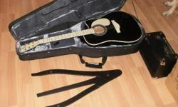 Black Guitar never used in case with DVD'S never opened and Amp Brand New Need to sell