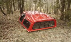 Fiberglass shell. Fits 1/2 ton trucks. Front and 2 side glass all sliding. Red. 870-460-5666 Conway
