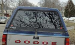 Fiberglass cap for a small box, blue, side windows,sliding window in front. Light in back.