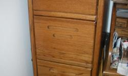 Three drawer solid oak cabinet with hanging file frames. Good condition.