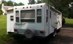 REDUCED WHOLESALE PRICE! 2009 Forest River Flagstaff 26rls. I will include a Reese Hitch with weight distribution bars and an anti-sway bar (a $500 value). This is a one owner super-lite travel trailer. Never smoked in and no pets.