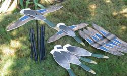 "These are full sized silhoettes as viewed from above, 25 inch wingspan. Metal stakes are in 2 sections, 54"" tall. Sturdy foam like material. Depicts 6 landing Mallards when viewed from above."