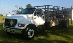33,000gvwr stake bed cat motor automatic,w ac and bench seat 20 ft aluminum bed