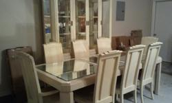 A mirrored Formal Dining Room set with 8 chairs and a china cabinet in excellent condition. Relocated and it does not fit in our house. $650 or best offer. Must be willing to pickup furniture.
