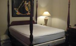 Beautiful four post queen bed - mattress and boxspring included