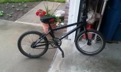 Black 2009 Free Agent Eluder. Made for dirt track. Willing to trade for a Mountain bike (Equal value).