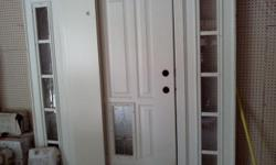 6 Foot door with decorative glass inserts and side panels. Located in Greenwood, buyer to pick up.